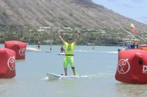 Australian Travis Grant, 32, wins his second stand up paddleboard (SUP) championship at M2O in a time of 4:59:38.